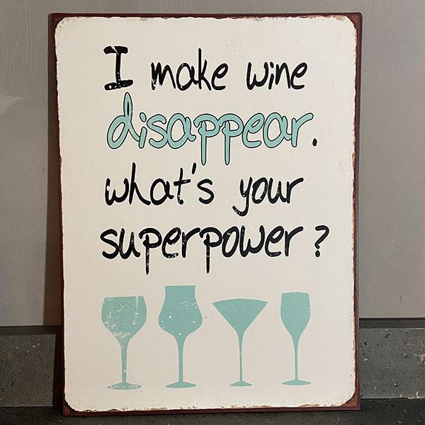 Plåtskylt-med-text,-I-make-wine-disappear