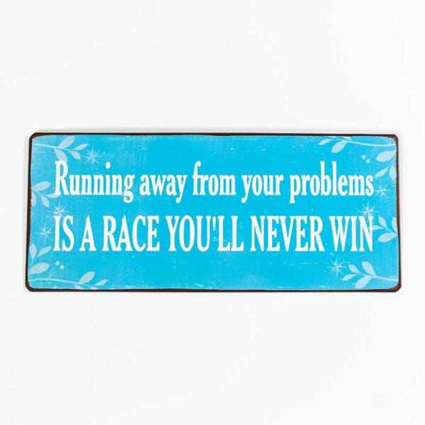 """Blå plåtskylt vit text och budskap """"Running Away From Your Problems Is A Race You'll Never Win"""""""