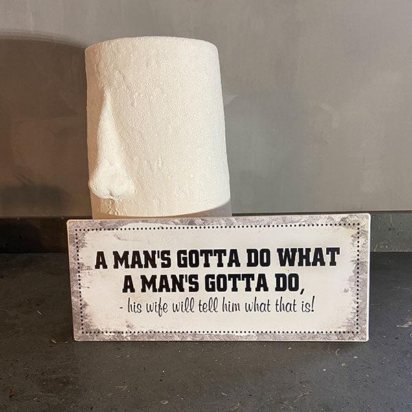 Plåtskylt med text, a mans gotta do