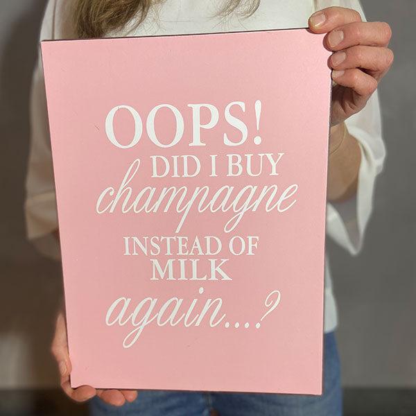 Plåtskylt med text oops did I buy champagne